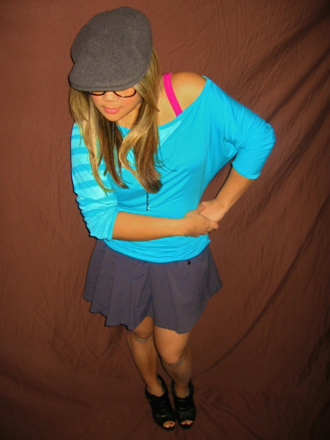 MidoriLei wears black peep toe booties, a gray pleated short skirt, teal off the shoulder 3/4th sleeve shirt, fuchsia bra, black nerdy glasses, and a gray felt hat