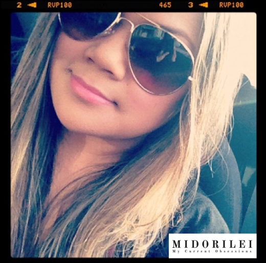 MidoriLei is in her car wearing aviator glasses