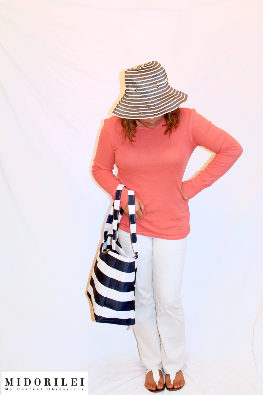 summer outfits, MidoriLei wears blue and white nautical striped tote and hat, coral top, white jeans, and white sandals