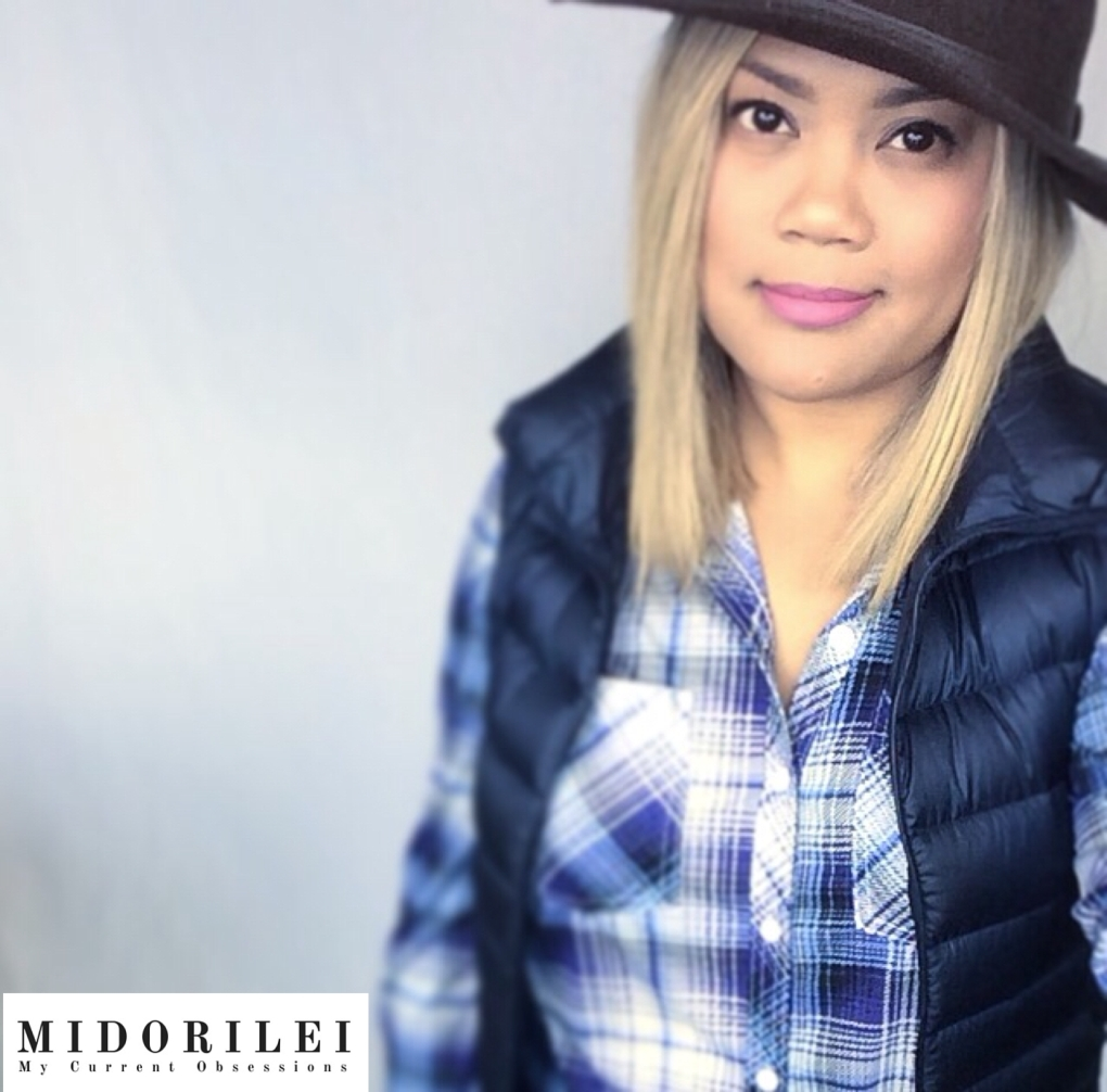 MidoriLei wears a brown felt hat, uiniqlo navy puffer vest and stretchy blue and white plaid shirt