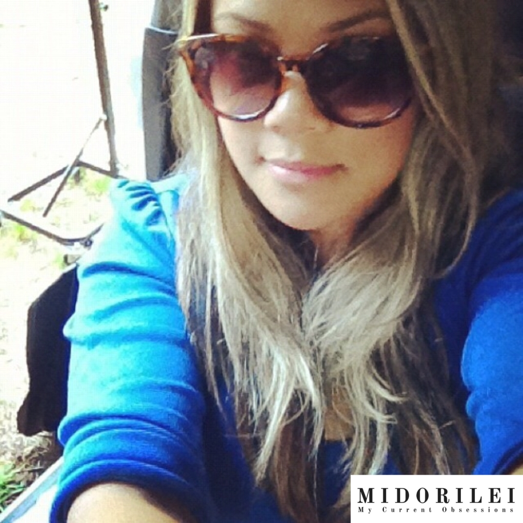 MidoriLei wears tortoise shell shell sunglasses and a blue 3/4th shirt