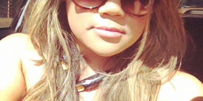 MidoriLei wears tortoise shell sunglasses, bluetooth