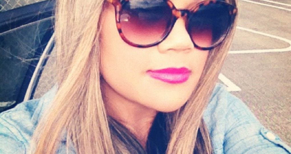 MidoriLei wears a chambray shirt, fuchsia lipstick, the color mean girls from too faced LA CRÈME COLOR DRENCHED LIP CREAM, and tortoise shell sunglasses with a gradient