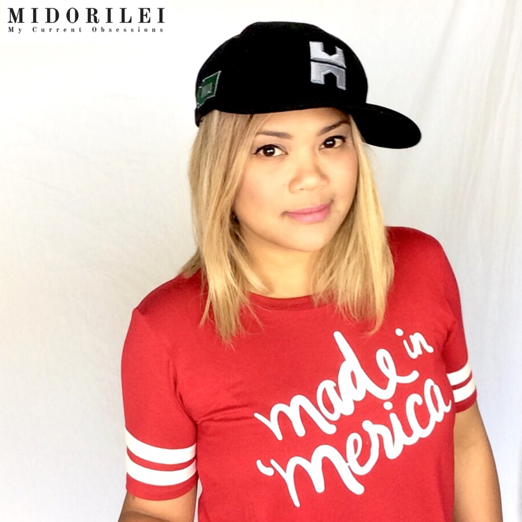 MidoriLei wears a black Hoffman Structures cap, and a red made in 'merica shirt with white stripes on the sleeves for Independence day