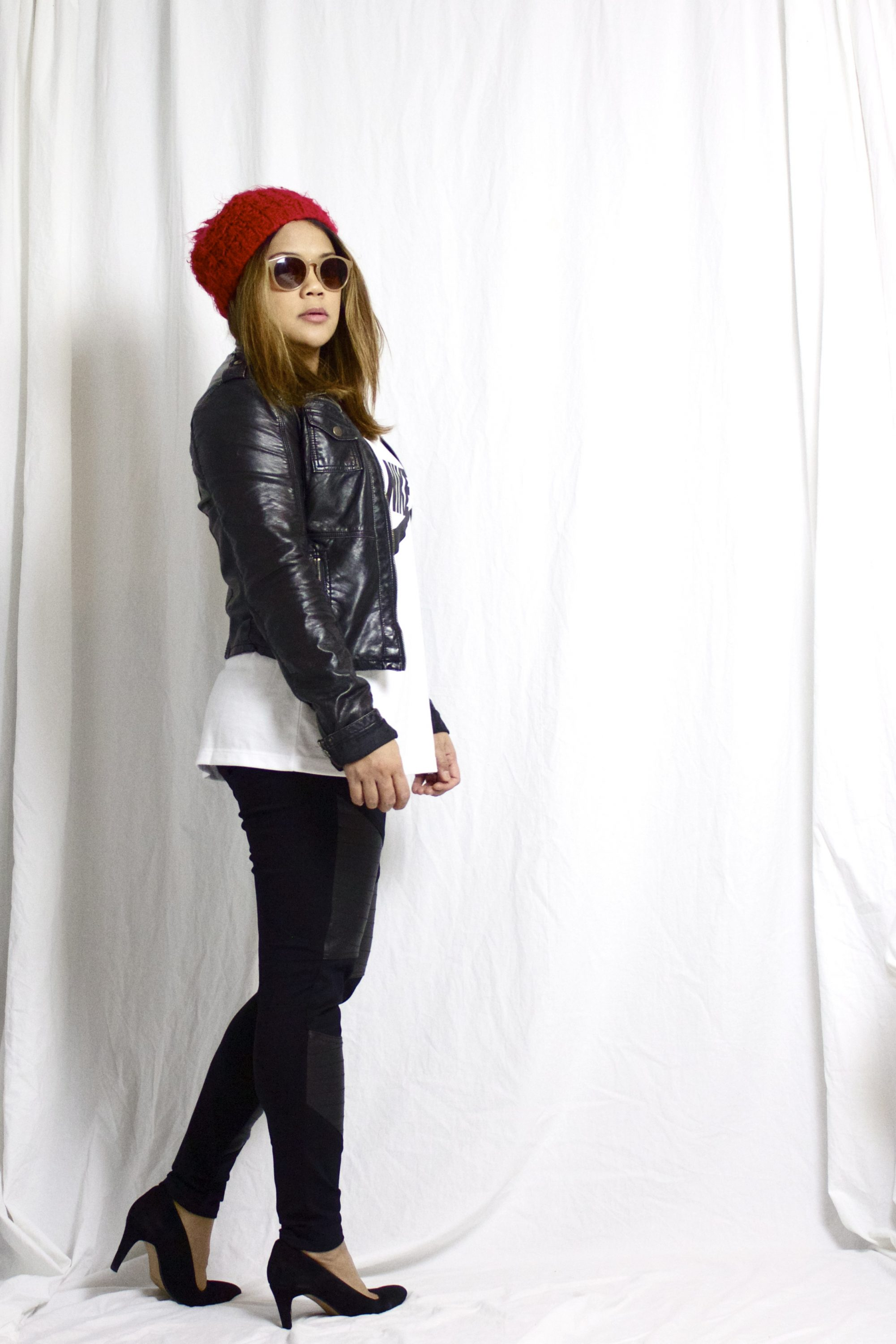 athleisure, street style, red beanie, nude sunglasses, nike top, moto jacket, leather jacket, outfit with leggings, black pumps, pop of color,